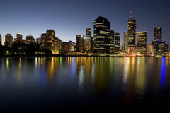 City skyline at dusk by river Royalty Free Stock Photography
