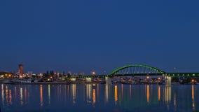 City skyline at dusk by river stock photos