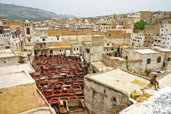 City skyline and dye pots at one of the tanneries in the ancient Royalty Free Stock Images
