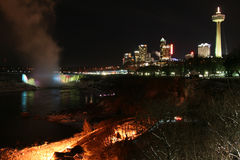 City Skyline at the Falls. Niagara Falls at night with city stock images