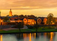 City skyline Leerdam the netherlands at sunset with water and park view. A city skyline of Leerdam the netherlands at sunset with water and park view stock photos