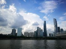 City skyline. Magnificent city nestled between giant rolling clouds and steely calm water Royalty Free Stock Photography