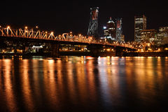 City skyline at night. Downtown Portland Oregon at night showing river and skyline Royalty Free Stock Images