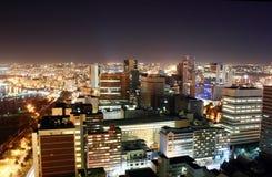 City skyline night. Night skyline scene of Durban city, South Africa from a very tall building Stock Photo