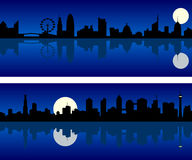 City Skyline at Night. Generic silhouette of a city skyline at night. Two banners with reflection. Eps file available Stock Image