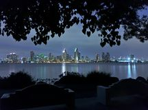City skyline at night as seen from park bench Stock Photo