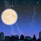 City skyline at night, buildings and big moon Stock Photography