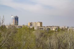 City skyline over trees from a bird`s-eye view. City skyline above trees from a bird`s-eye view - background stock photo