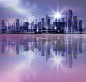 City skyline with reflection in water. Harbor and city at night with reflection in water Stock Photo