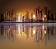 City skyline with reflection in water. Harbor and city at night with reflection in water Royalty Free Stock Photo