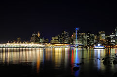 City Skyline Reflection on water at night. BC, Canada Royalty Free Stock Photo