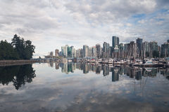 City skyline reflections in ocean bay from Stanley park Royalty Free Stock Photos
