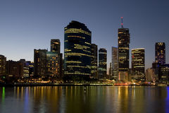 City skyline with river. In foreground at dusk Royalty Free Stock Photography