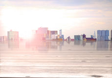 City skyline with sun effect with wooden foreground Royalty Free Stock Image