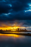 City Skyline  at Sunrise or Sunset with Water in Foreground Royalty Free Stock Images