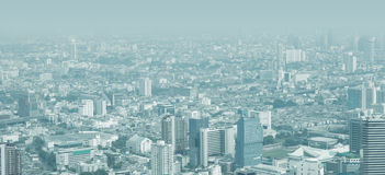 City skyline through the thick smog Royalty Free Stock Image