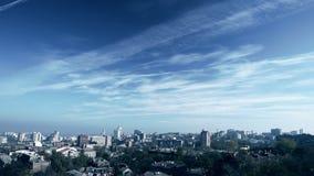 City skyline. Timelapse. City skyline. Clouds fly over the city. Timelapse stock video