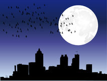City skyline under moon Stock Image