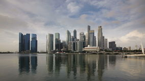 City skyline view across marina bay to the financial and business district stock video footage
