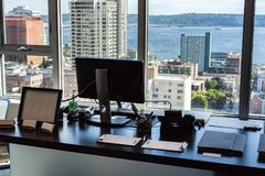 High rise office view of the city. City skyline viewed from high rise office with large windows Stock Photos