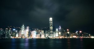 City skyline viewed from sea at night Stock Photography