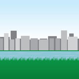 Skyline Water Grass. City skyline with water and grassy field Royalty Free Stock Photos