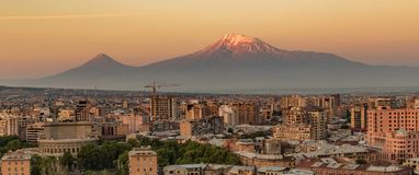 City skyline of Yerevan at sunrise, with Mt Ararat in background. City skyline of Yerevan, Armenia at sunrise, with Mt Ararat in background Royalty Free Stock Photos