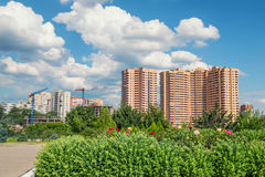 City skyscape with clouds on sunnny day. Blue sky and white clouds above buildings in modern city royalty free stock photos