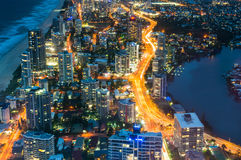 City skyscrapers and traffic at night, aerial, long exposure. City skyscrapers and busy highway traffic at night, aerial, long exposure. Futuristic cityscape Royalty Free Stock Photos