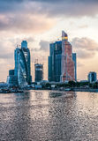 City Skyscrapers under construction at sunset with clouds over a river. Moscow City Skyscrapers being built overlooking the river at sunset Royalty Free Stock Images