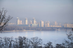 City in smog. Modern buildings in the haze, in smog, on the banks of the Dnieper River in the spring, Kiev, Ukraine Royalty Free Stock Photos