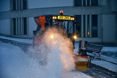 Free City Snow Plough Cleaning Snow On City Street. City Snow Plow Truck. Royalty Free Stock Photo - 138135545