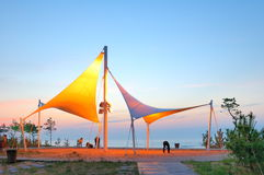 The city is soft carve and mould in seashore. Evening, the city is soft sculpture is in seashore , juat now bright light , people takes a walk in lying fallow Stock Image