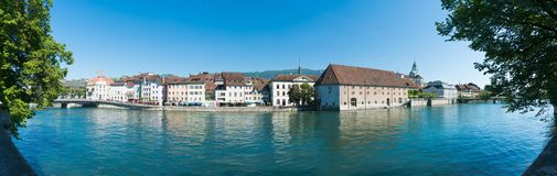 Solothurn, SO / Switzerland - 2 June 2019: city of Solothurn with the river Aare and a panorama cityscape view of the old town. City of Solothurn with the river royalty free stock images