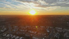 City Space view colorful sunset exploding sky in vivid colors over housing community development. Space view colorful sunset exploding sky in vivid colors over stock video footage