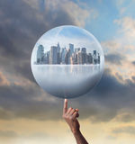 City sphere. Man's hand holding a sphere with cityscape in it Royalty Free Stock Photography