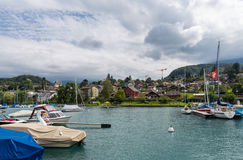 City of Spiez. View on beautiful small city, lake Thun, marine and many boats. City of Spiez, canton Bern, Switzerland Stock Photo