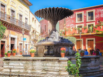 City Square, Guanajuato, Mexico. People meet and talk in a charming, colorful city plaza with a fountain in Guanajuato, Mexico, a colonial era city that is a Stock Images