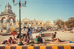 City square with some local fruits and vegetables sellers waiting for the customers outdoor Stock Images
