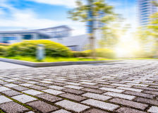 City Square. A texture of City Plaza pavement and the distant background of modern architecture Royalty Free Stock Photography