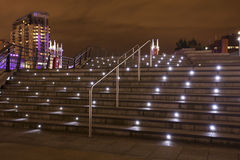 City steps at night. Modern buildings in a city steps lit up at night Royalty Free Stock Image