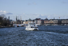 The city of Stockholm, the harbor. A view of the city of Stockholm on a beautiful sunny day. There`s a ferry sailing into the harbor Stock Photography