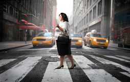 City street. Fat woman crossing a city street Royalty Free Stock Photos