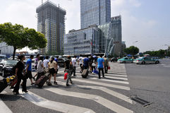 City street. Some travellers are throughing the zebra line,at hangzhou city china,photo taken in Sep 2, 2011 Stock Photos