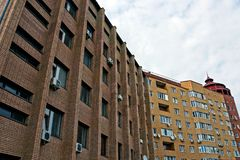 City street with brown apartment buildings, balconies and windows Royalty Free Stock Photo