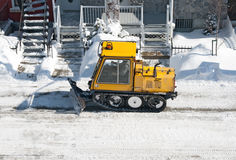 City street cleaned from snow by a snowplough royalty free stock photography