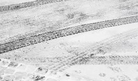 City street covered with snow tyre tire tracks in winter. Blurry city street covered with snow tyre tire tracks in winter stock images