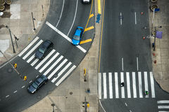 City street with crosswalks on asphalt road and car traffic. Royalty Free Stock Photos