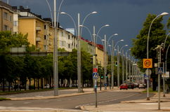 City street before the downpour. Storm clouds gather over a street in Helsinki, Finland; photo taken July 10, 2016 Stock Photos