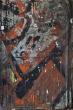 City street graffiti background. Graffiti on a rough textured city wall background Stock Images